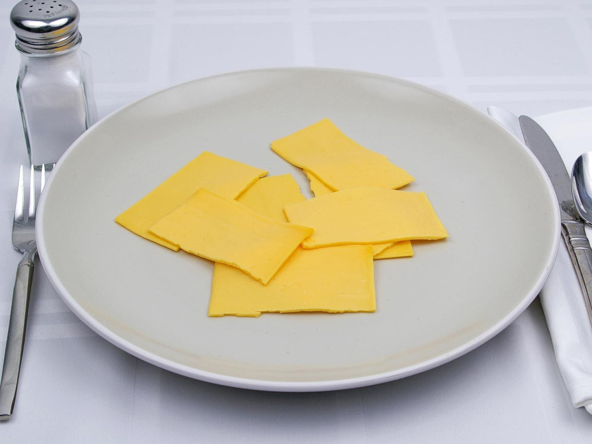 Calories in 4 slice of American Cheese - Fat Free Singles