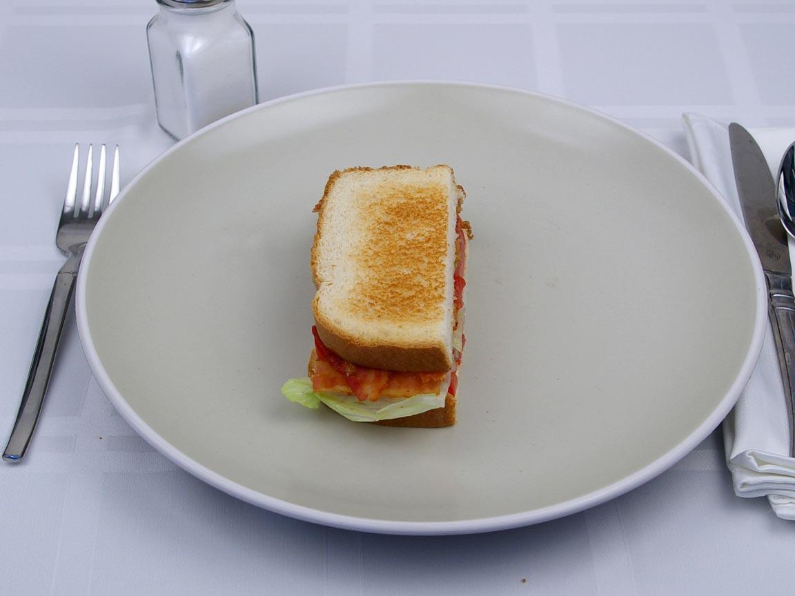 Calories in 0.5 sandwich(es) of Bacon Lettuce Tomato Sandwich