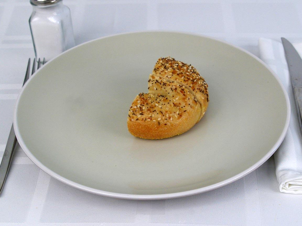 Calories in 0.5 bagel(s) of Einsteins Bagel - Everything