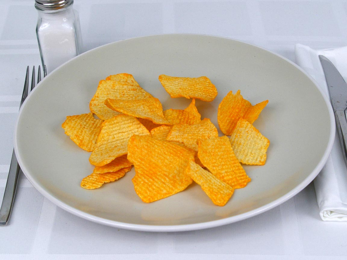 Calories in 28 grams of Ruffles Baked Cheddar and Sour Cream Chips