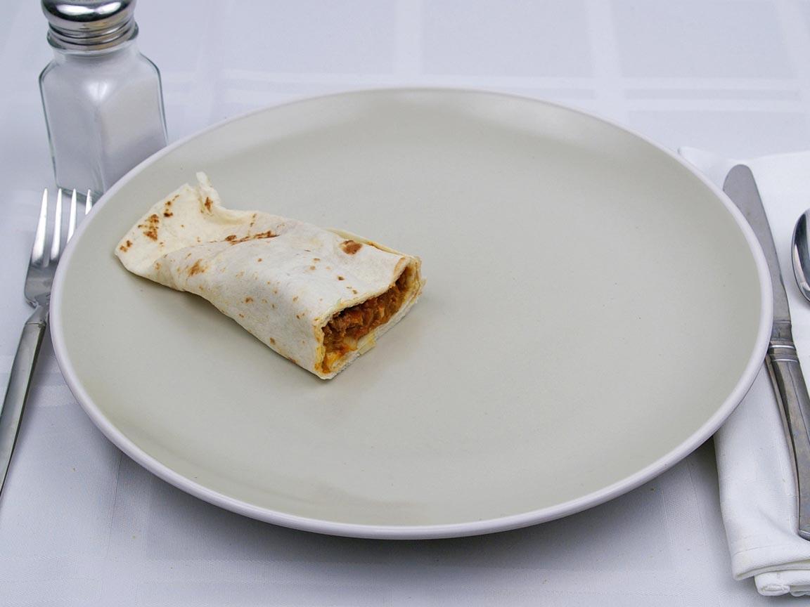 Calories in 0.5 burrito(s) of Taco Bell - Burrito Supreme - Beef