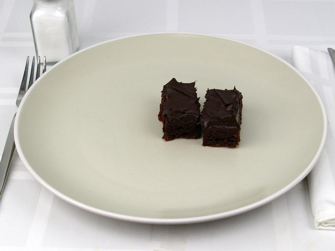 Calories in 0.5 brownie(s) of Frosted Chocolate Brownie