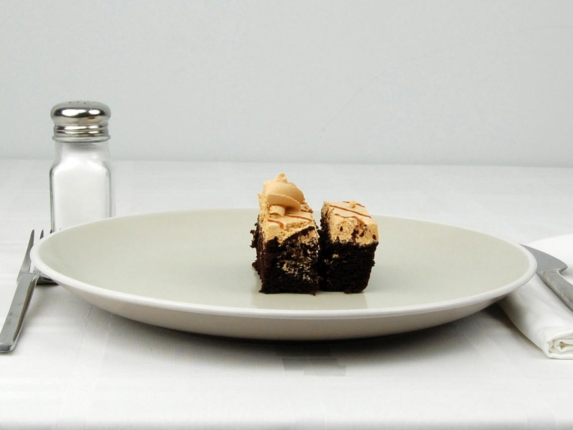 Calories in 0.5 piece(s) of Cake - Snickers