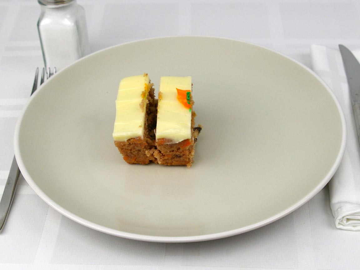 Calories in 0.5 piece(s) of Carrot Cake