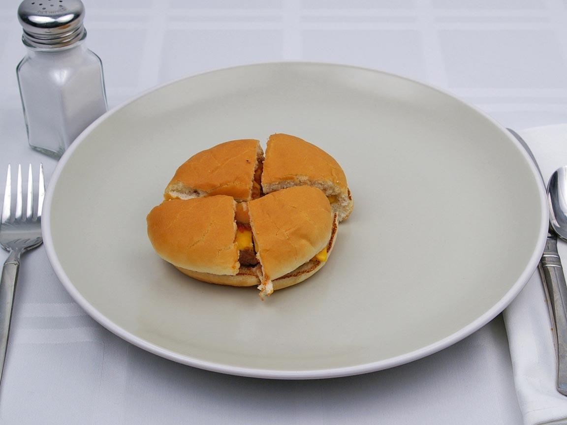 Calories in 1 burger(s) of McDonald's - Cheeseburger