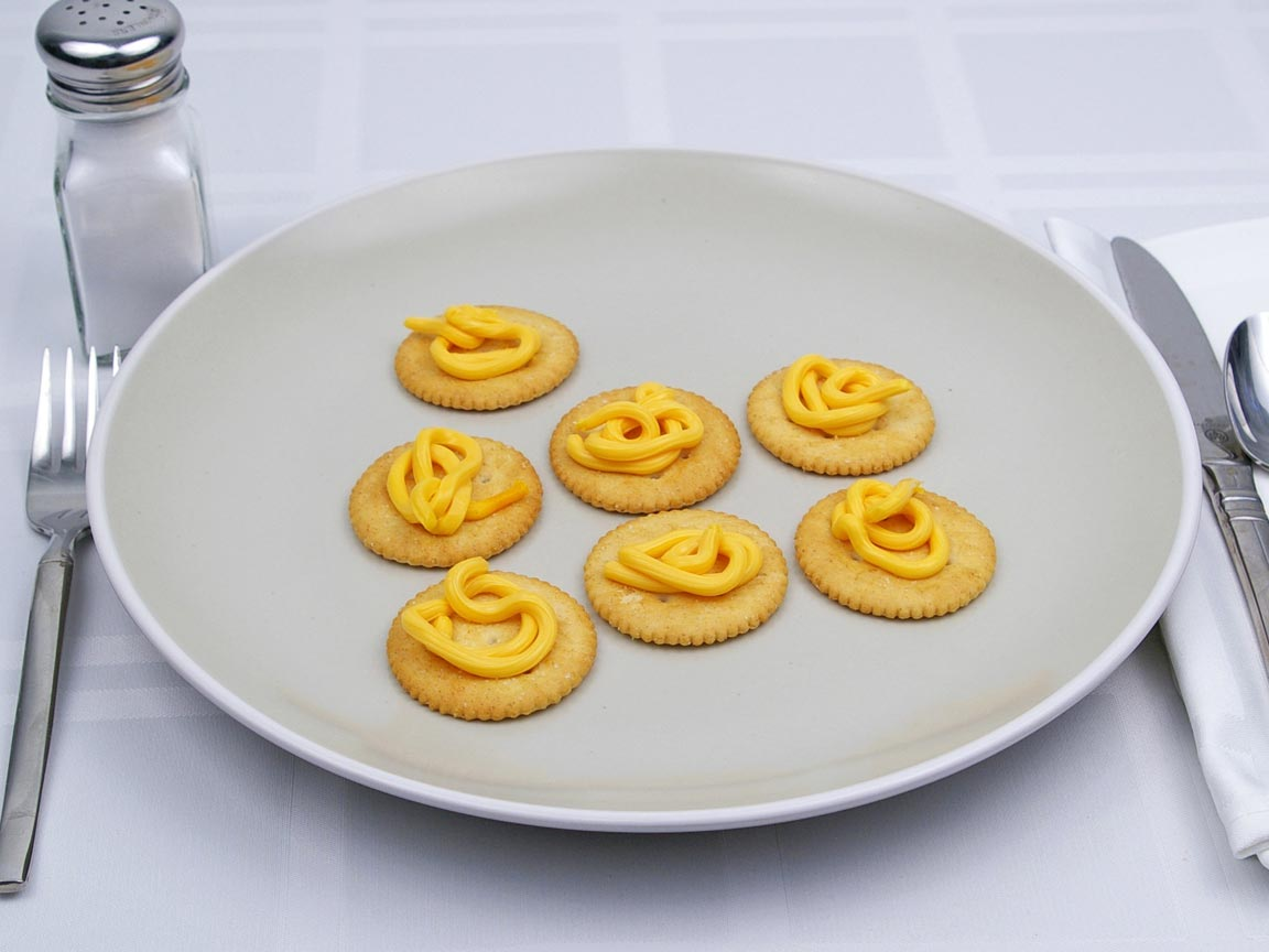 Calories in 7 tsp(s) of Easy Cheese - Shown on Cracker