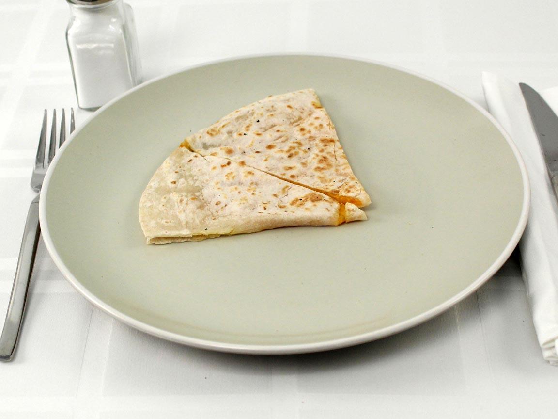 Calories in 0.5 quesadilla(s) of Del Taco Cheddar Quesadilla