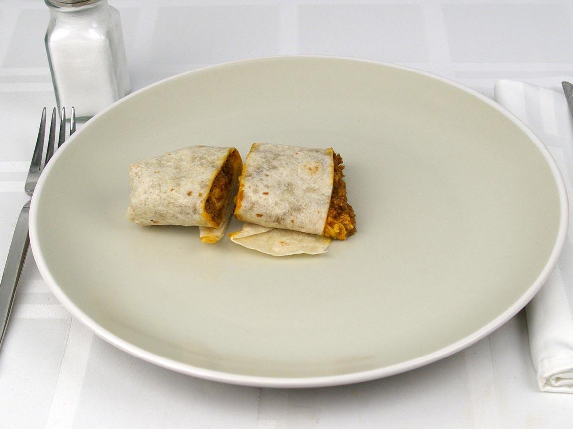 Calories in 0.5 burrito(s) of Del Taco - Del Beef Burrito with cheese