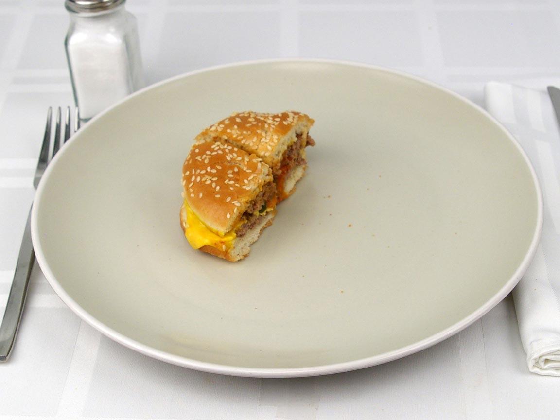 Calories in 0.5 burger(s) of Burger King Double Cheeseburger