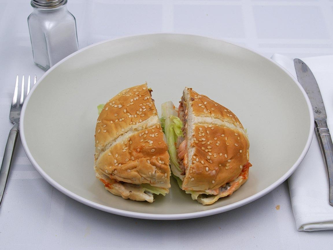 Calories in 1 hamburger(s) of Carl's Jr - Famous Star Hamburger
