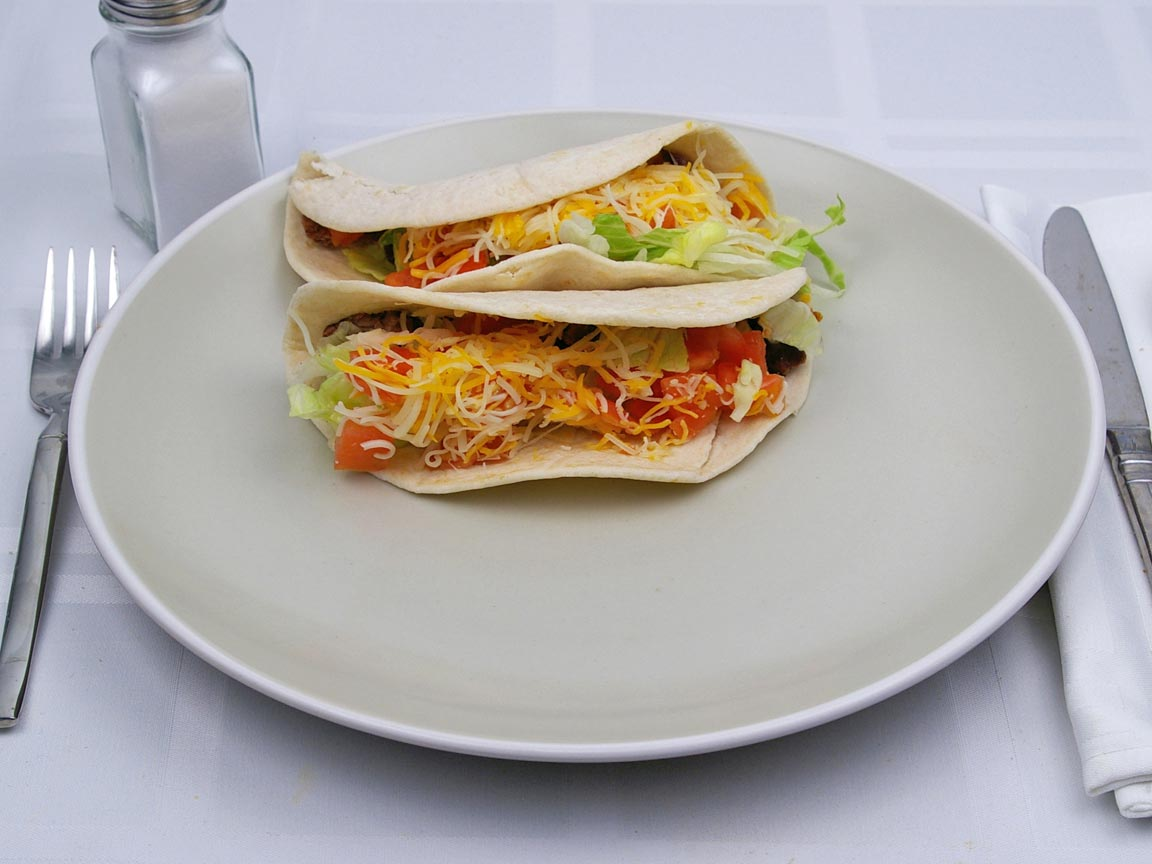 Calories in 2 taco(s) of Baja Fresh - American Soft Taco - Steak - Flour