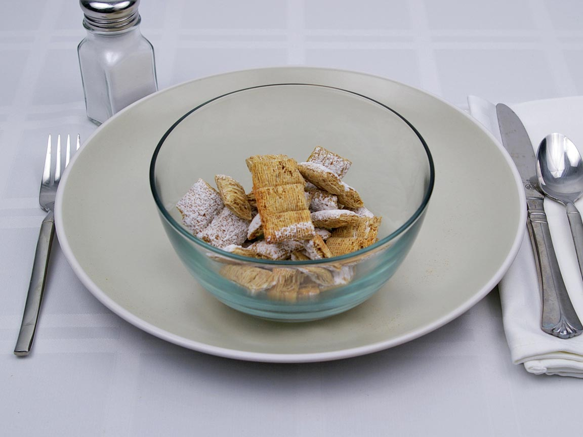 Calories in 1.25 cup(s) of Frosted Mini Wheats Cereal