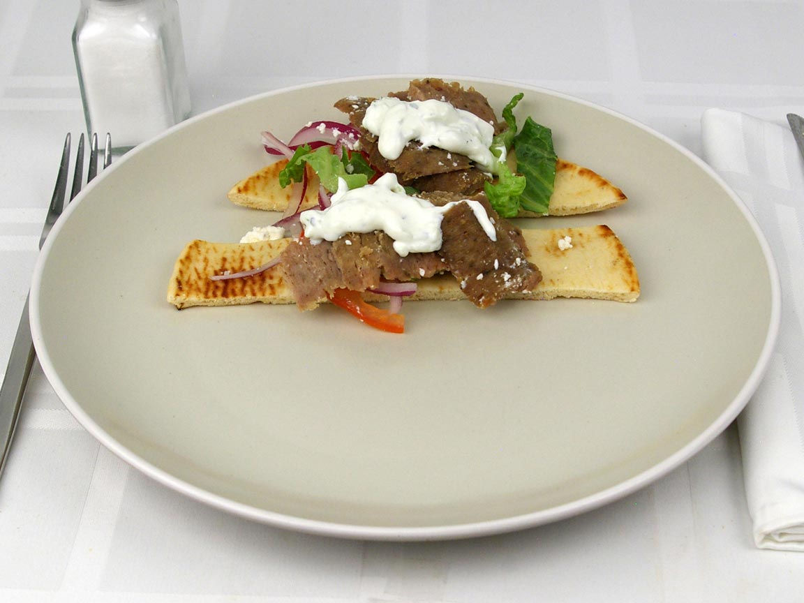 Calories in 0.5 gyro(s) of Gyro - Beef and Lamb - Feta - Tzatziki 2Tbsps