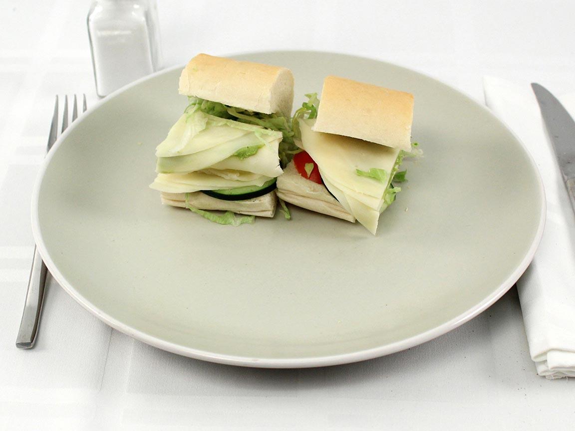 Calories in 0.5 8 inch(s) of Jimmy John's #13 Gourmet Veggie Club