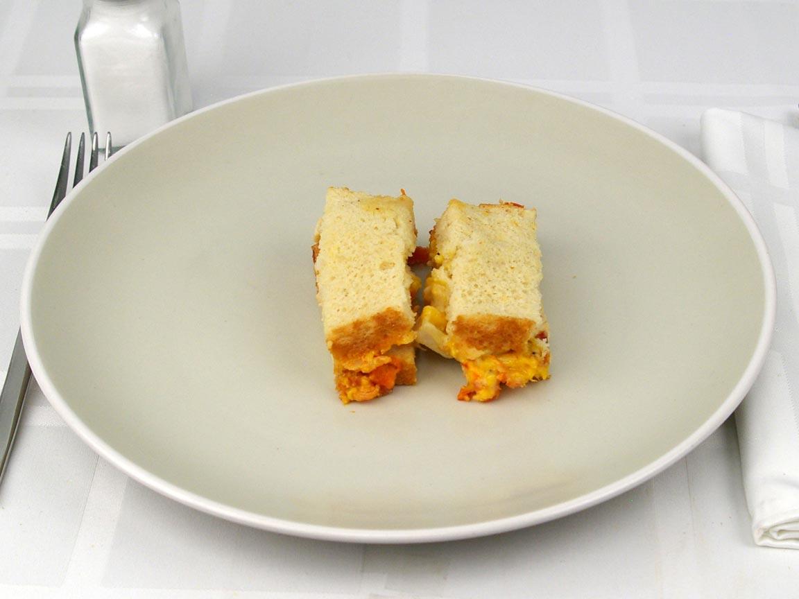 Calories in 0.5 panini(s) of Lean Cuisine Chicken Club Panini