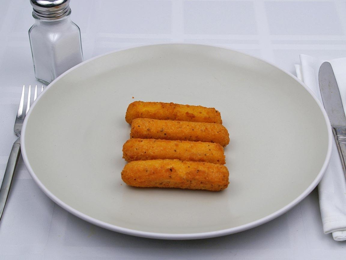 Calories in 4 piece(s) of Arby's  - Mozzarella Sticks