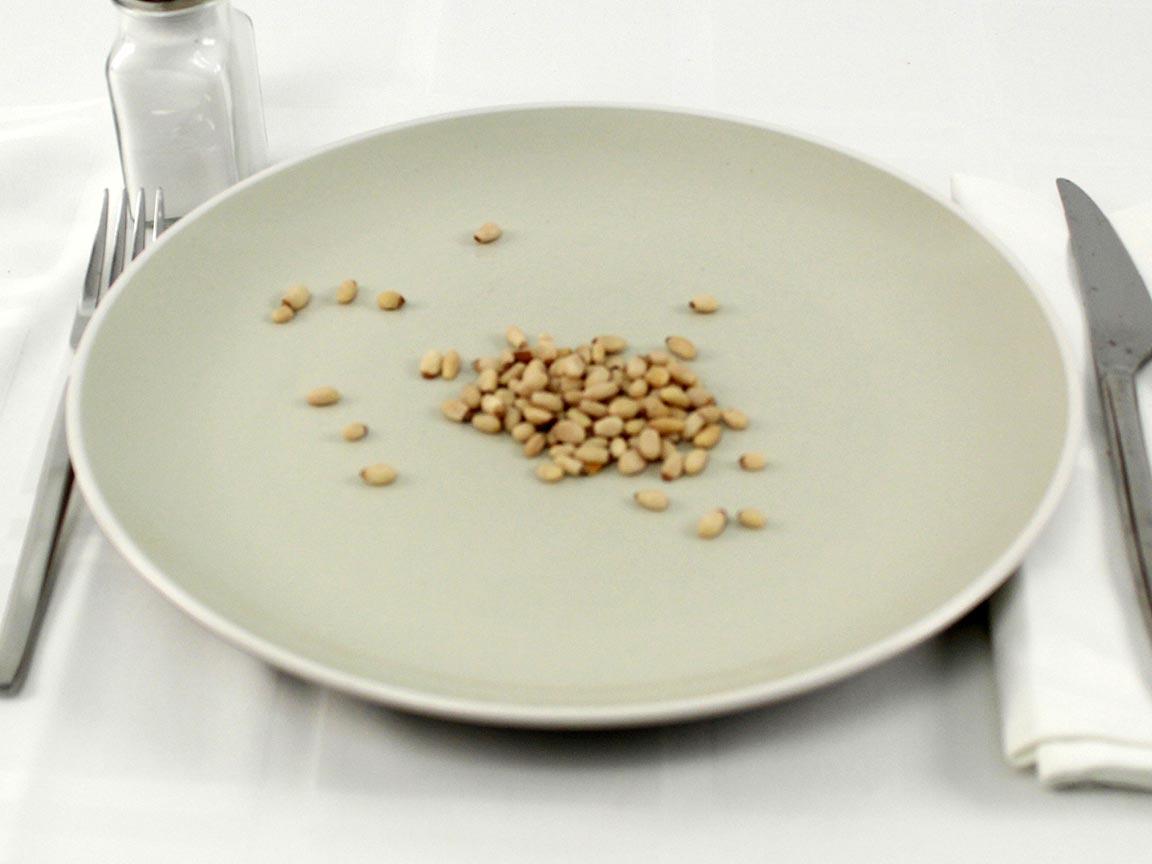 Calories in 56 grams of Pine Nuts