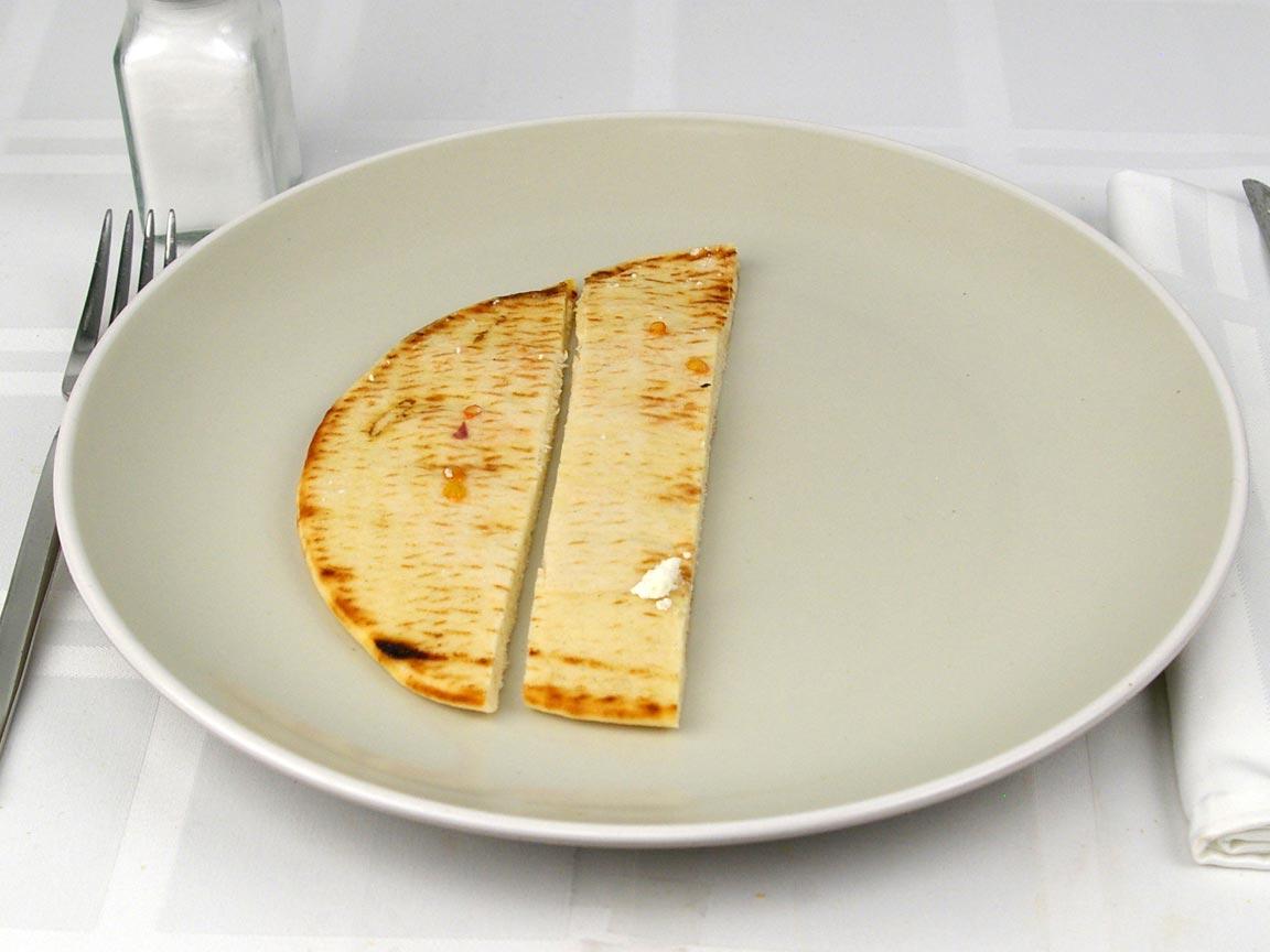 Calories in 0.5 pita(s) of Pita Bread - White