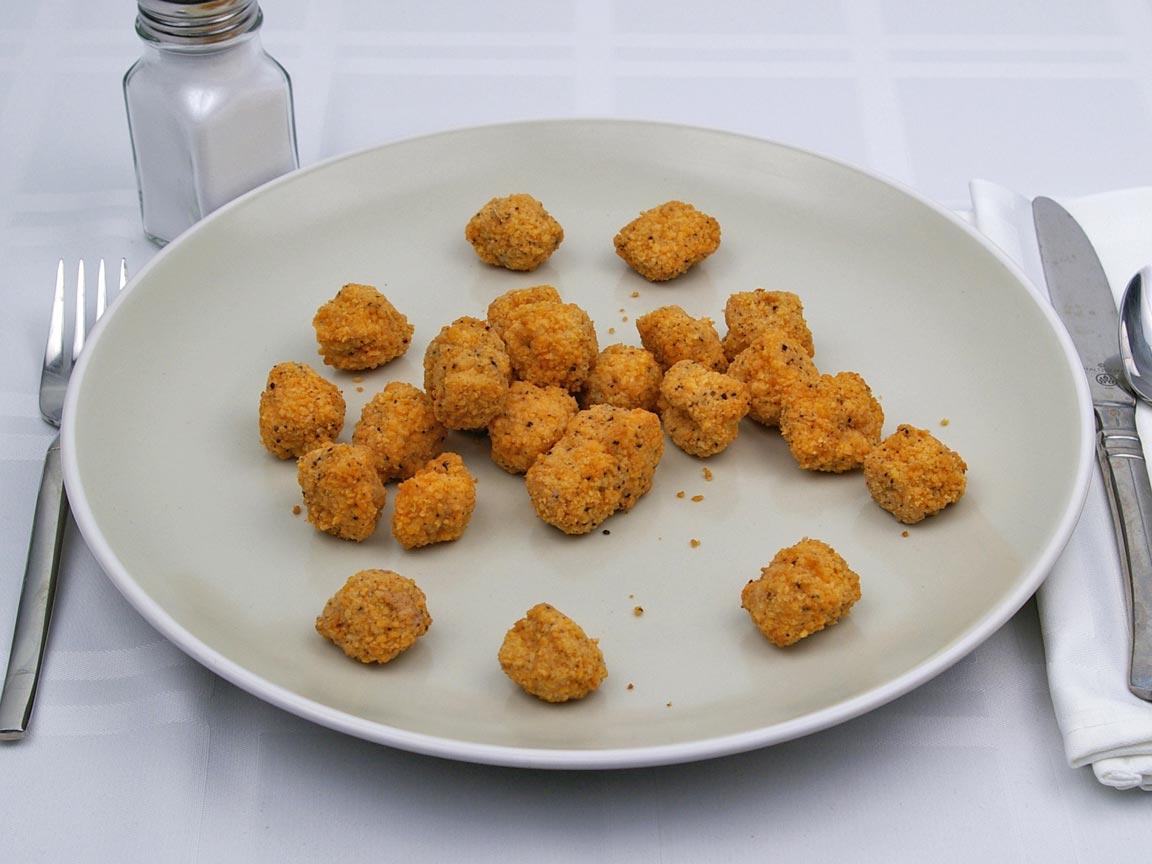 Calories in 24 piece(s) of Popcorn Chicken - Oven Heated