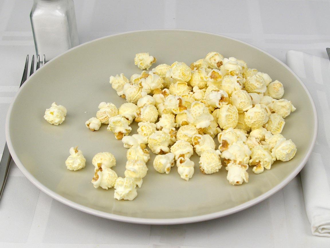 Calories in 21 grams of Popcornopolis White Cheddar Popcorn