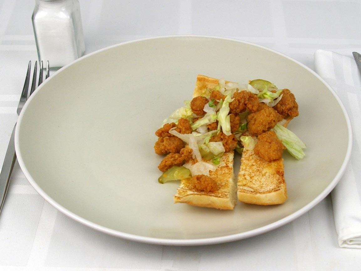 Calories in 0.5 sandwich(s) of Popeye's Shrimp Po'boy