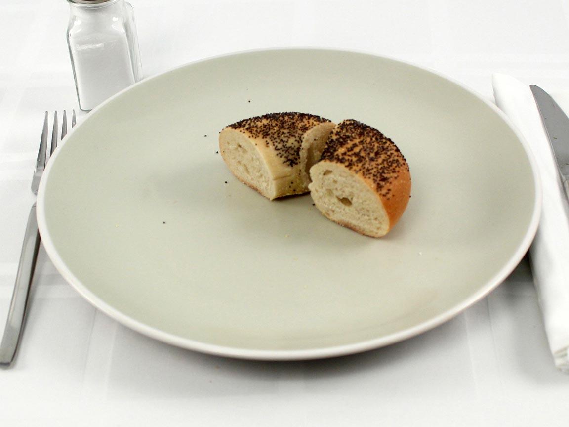 Calories in 0.5 bagel(s) of Poppy Seed Bagel
