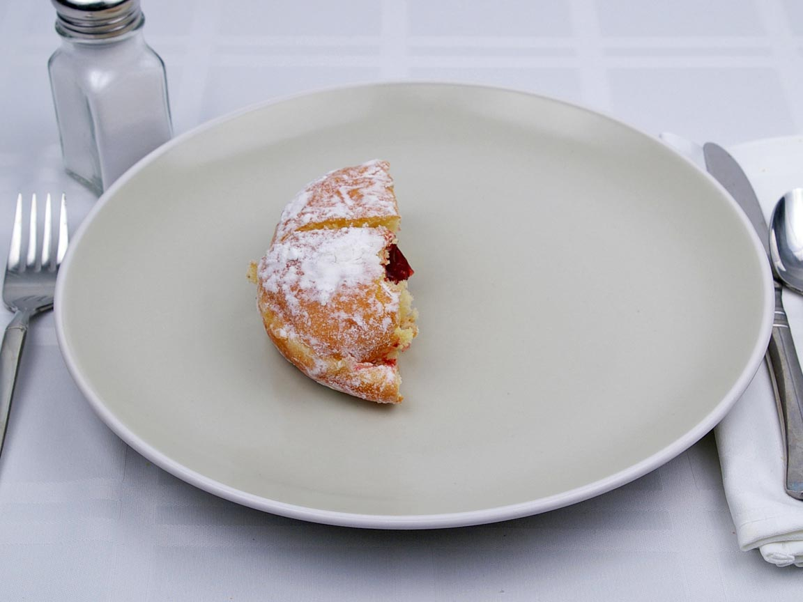 Calories in 0.5 donut of Powdered Jelly Filled Donut
