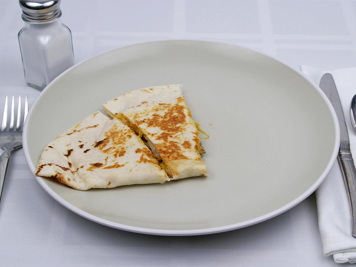 Calories in 0.5 quesadilla(s) of Taco Bell - Chicken Quesadilla