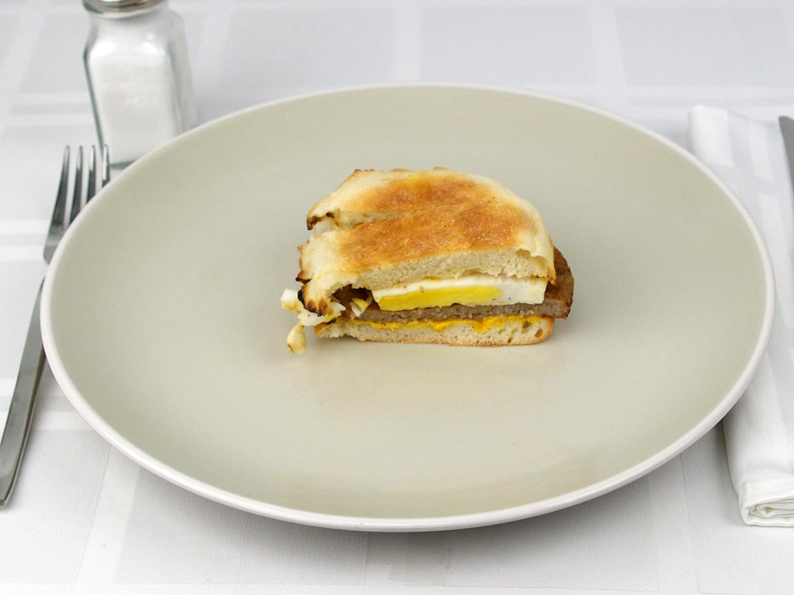 Calories in 0.67 sandwich(s) of McDonald's Sausage McMuffin with Egg