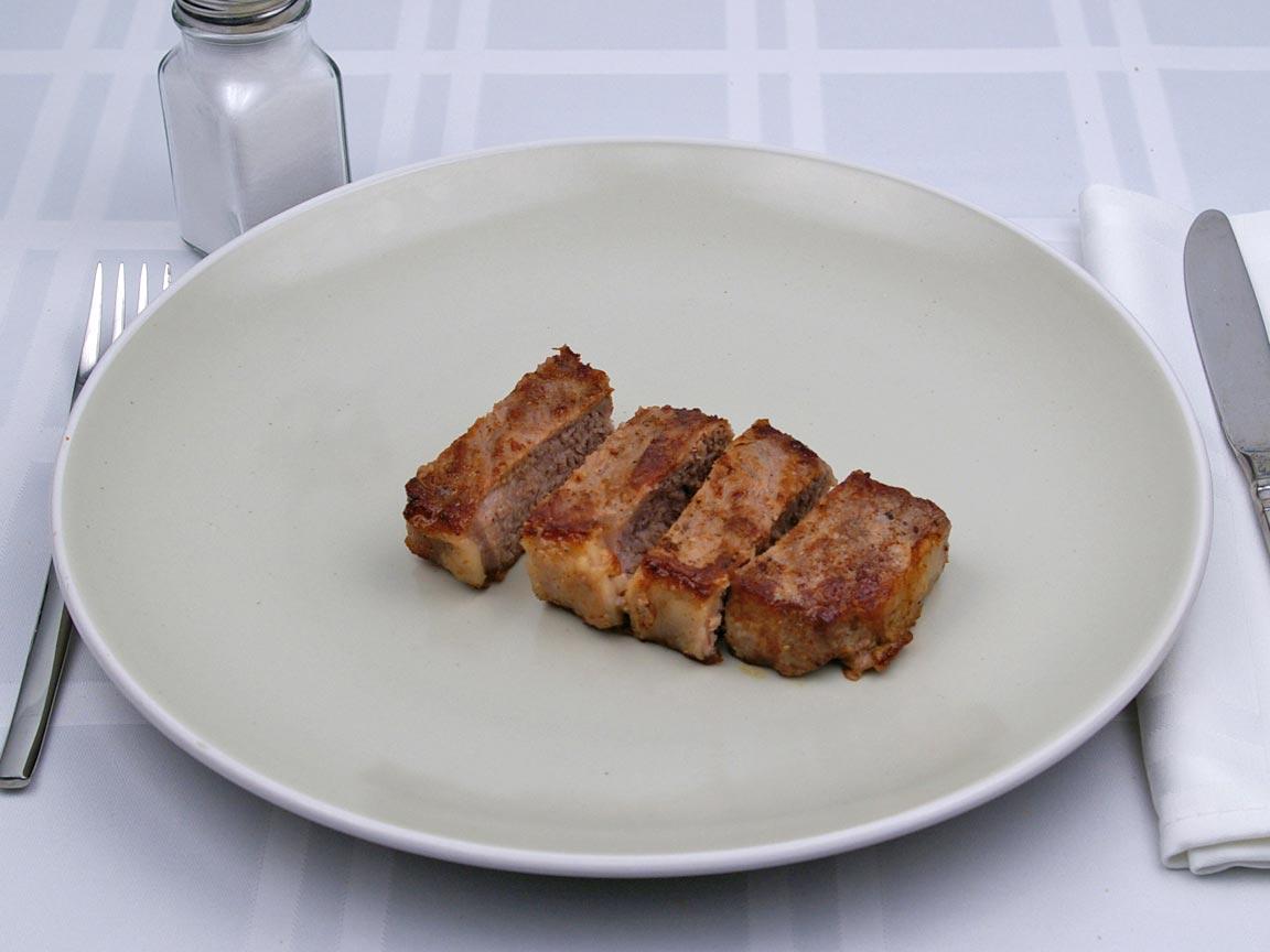 Calories in 113 grams of New York Strip Steak - Short Loin