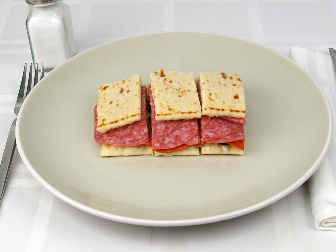 Calories in 0.75 sandwich(s) of Subway Flatbread Sp Italian Cheese No Mayo