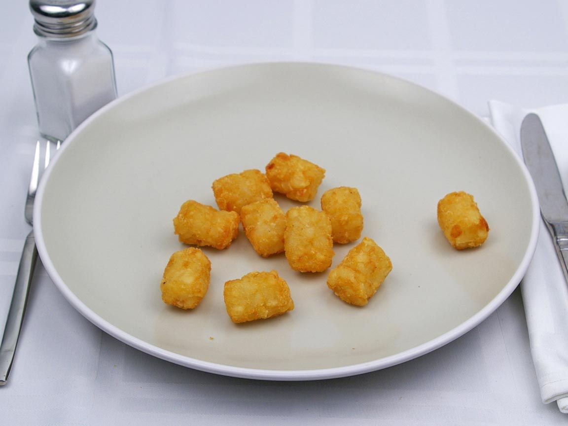 Calories in 85 grams of Tater Tots -Frozen Oven Heated