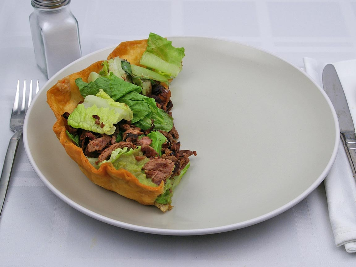 Calories in 0.5 tostada(s) of Baja Fresh - Tostada - Steak