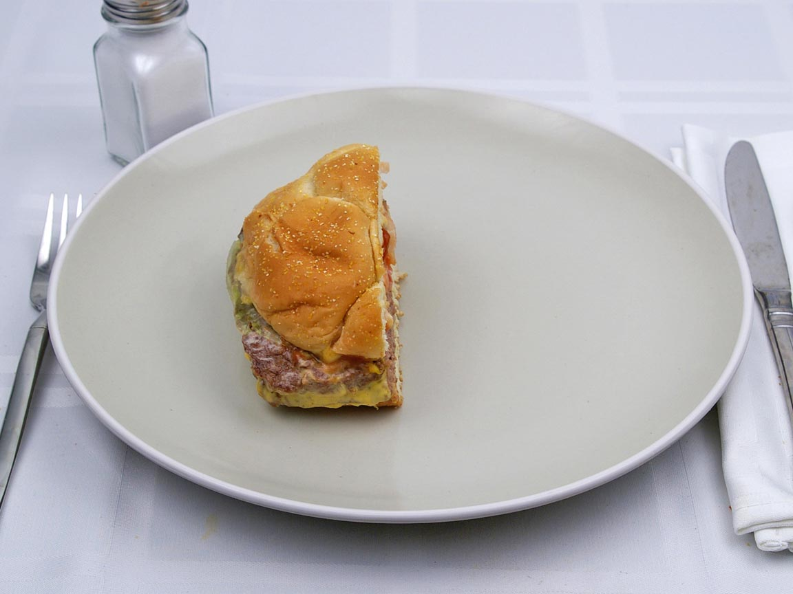 Calories in 0.5 sandwich(es) of Wendy's - Triple Hamburger