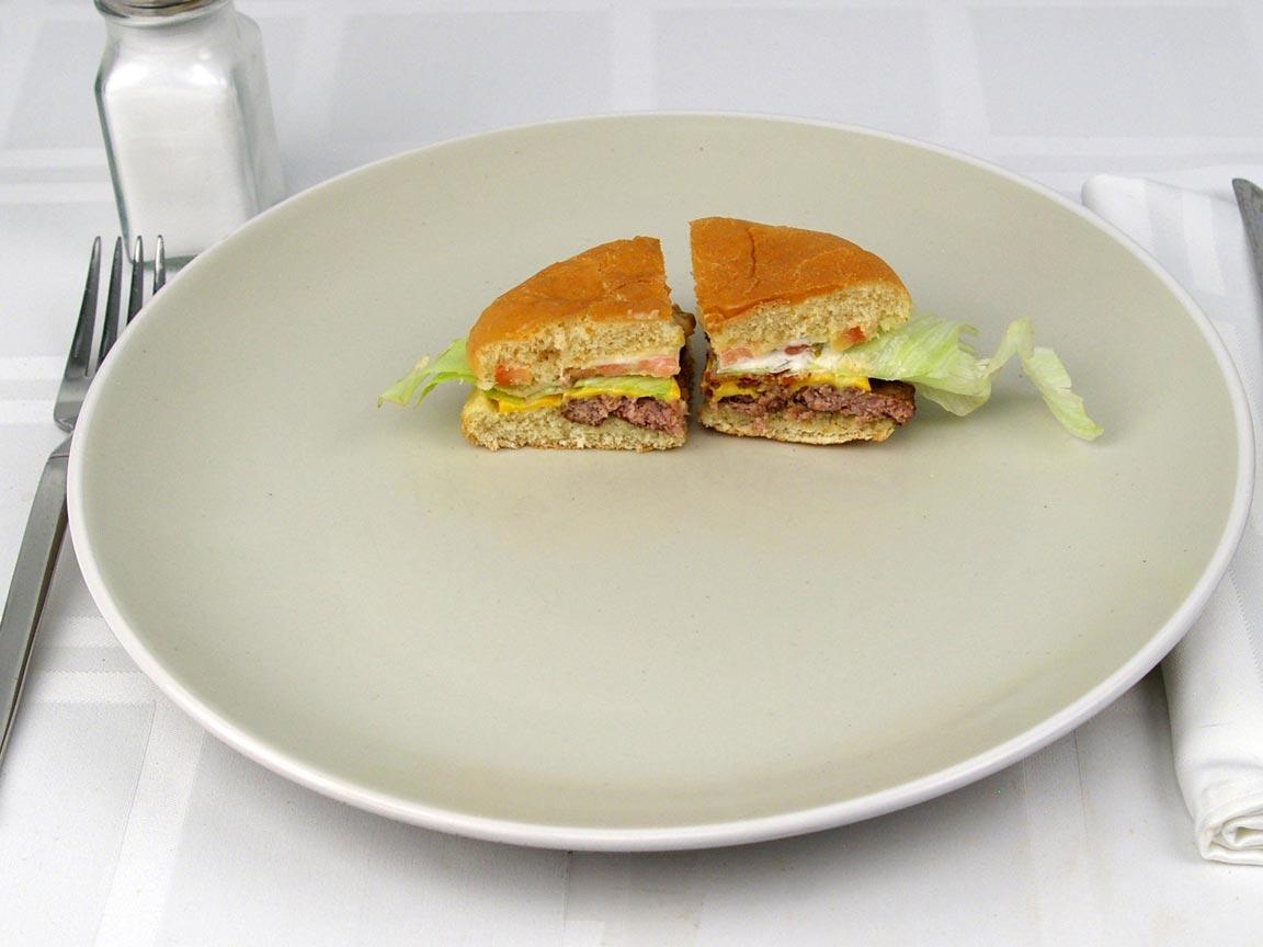 Calories in 0.5 burger(s) of Wendy's Jr. Bacon Cheeseburger