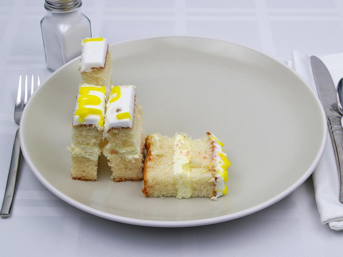 Calories in 4 piece of White Sheet Cake - Frosted